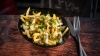 Aioli and gherkins loaded fries